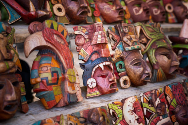Mexican culture. Souvenirs from the trip. Masks on the shelf stock photo