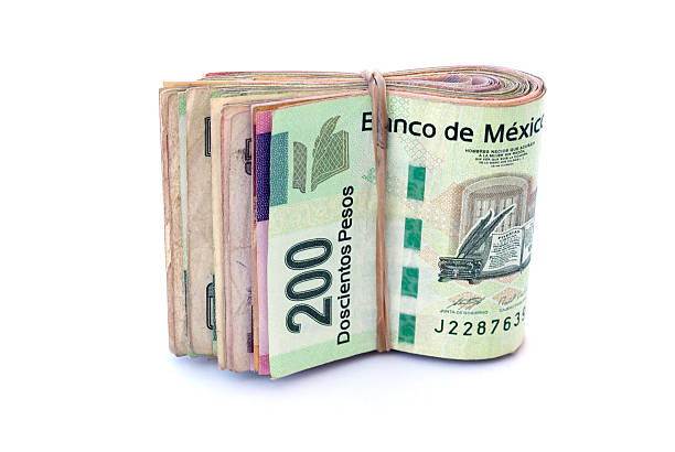 Mexican Currency A Stack of Mexican Currency bills bringing home the bacon stock pictures, royalty-free photos & images
