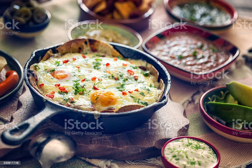 Mexican Eggs and Tortilla Chips with Salsa and Jalapenos stock photo