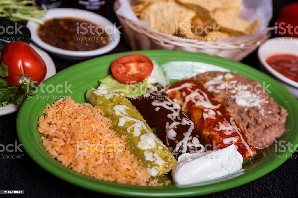 Mexican enchiladas trio with rice and beans stock photo