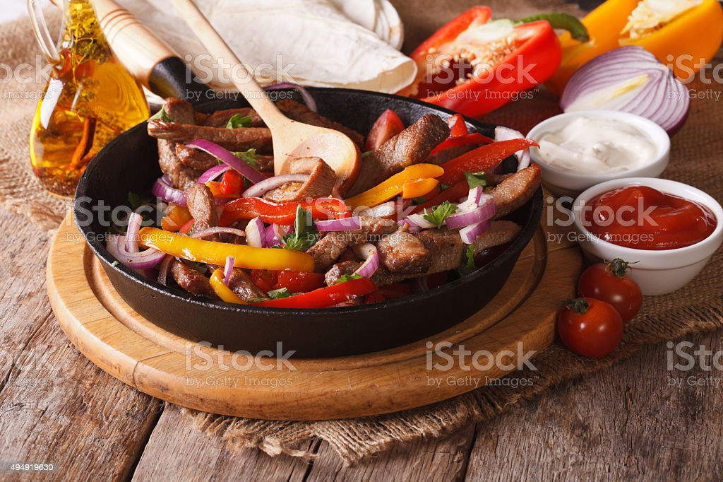 Mexican fajitas and ingredients close-up, horizontal stock photo