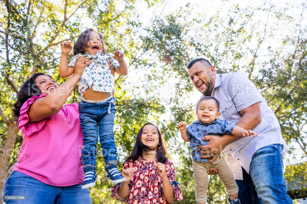 Mexican Family Playing in the Park royalty-free stock photo