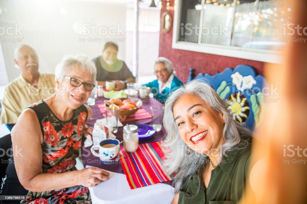 Mexican Family Takes a Selfie at Dinner royalty-free stock photo