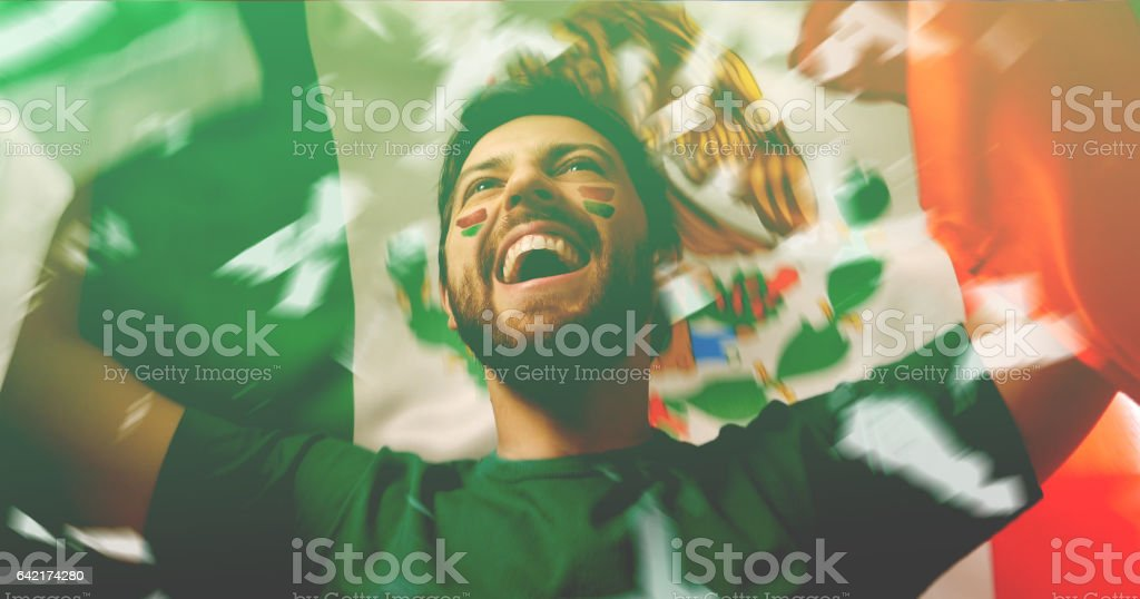 Mexican fan celebrating stock photo
