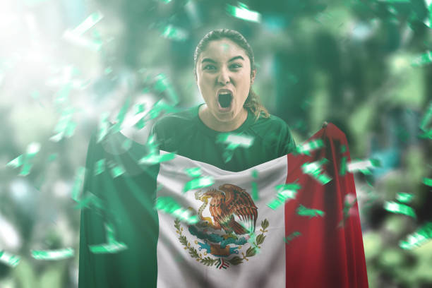 Mexican fan holding the national flag stock photo