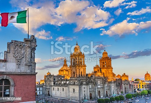 Mexican Flag Metropolitan Cathedral and President's Palace in Zocalo, Center of Mexico City Mexico Afternoon