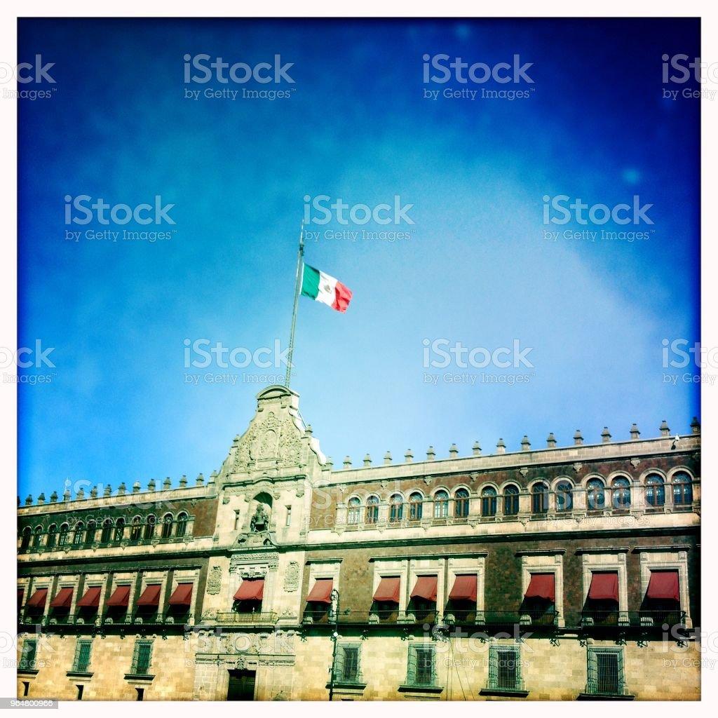 Mexican flag on Palacio Nacional, Mexico City royalty-free stock photo