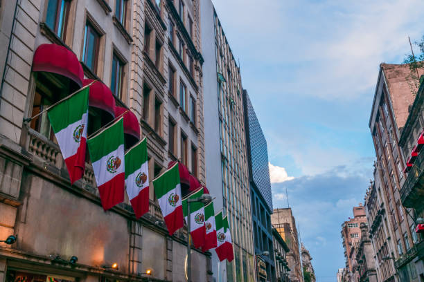 Mexican flags in the street stock photo