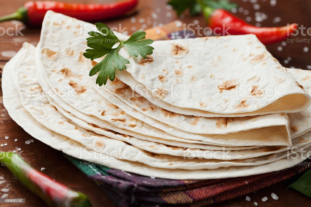 Mexican flatbread tortilla with chili pepper and parsley stock photo