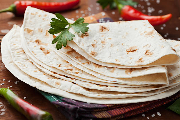 mexican flatbread tortilla with chili pepper and parsley - tortilla stock photos and pictures