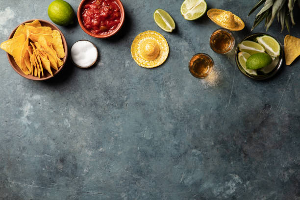 Mexican food and tequila shots, flat lay stock photo