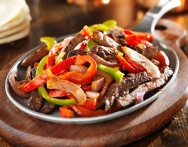 mexican food - beef fajitas and bell peppers stock photo
