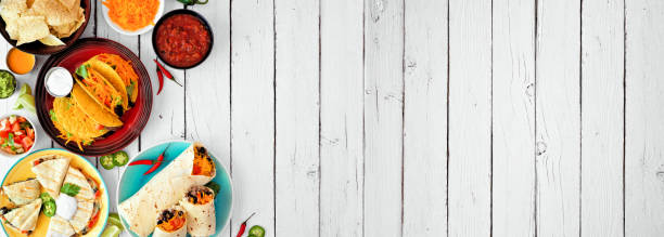 Mexican food corner border, top view over a white wood banner background with copy space stock photo