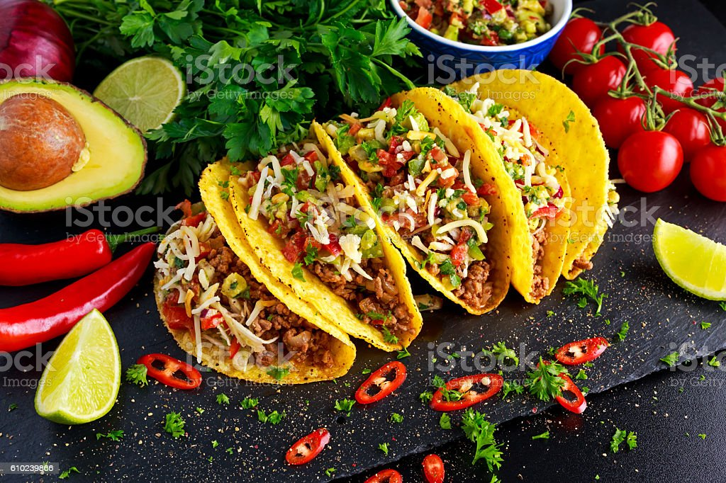 Mexican food - delicious taco shells with ground beef and ストックフォト