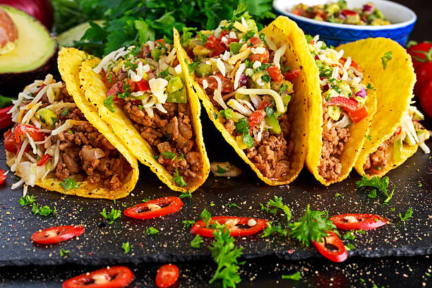 Mexican food - delicious taco shells with ground beef and Mexican food - delicious taco shells with ground beef and home made salsa. taco stock pictures, royalty-free photos & images