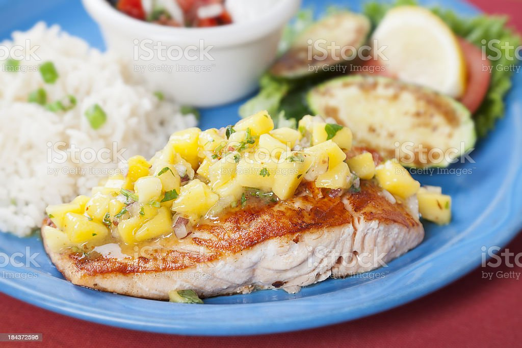 Mexican food:  Flame broiled salmon with mango salsa royalty-free stock photo