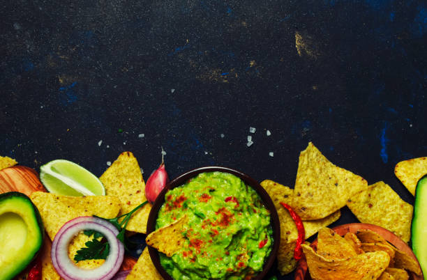 mexican food, guacamole sauce with avocado, onion, garlic and chili - mexican food stock photos and pictures