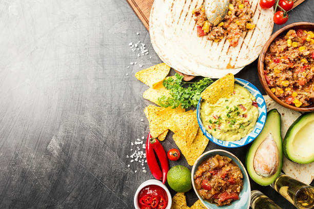 mexican food mix - mexican food stock photos and pictures