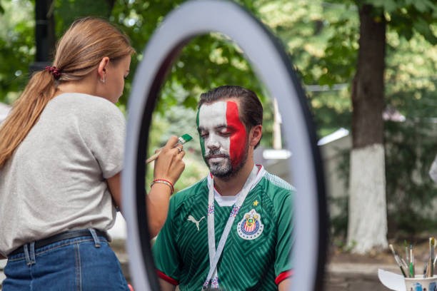 mexican football fans - group d stock photos and pictures