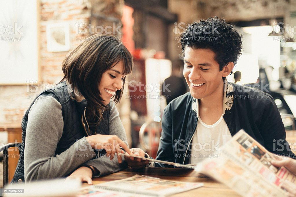 Mexican Friends hanging out in Coffeeshop stock photo