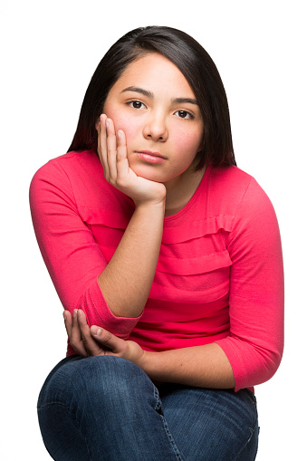 117149457 istock photo Mexican girl looking serious 483901720