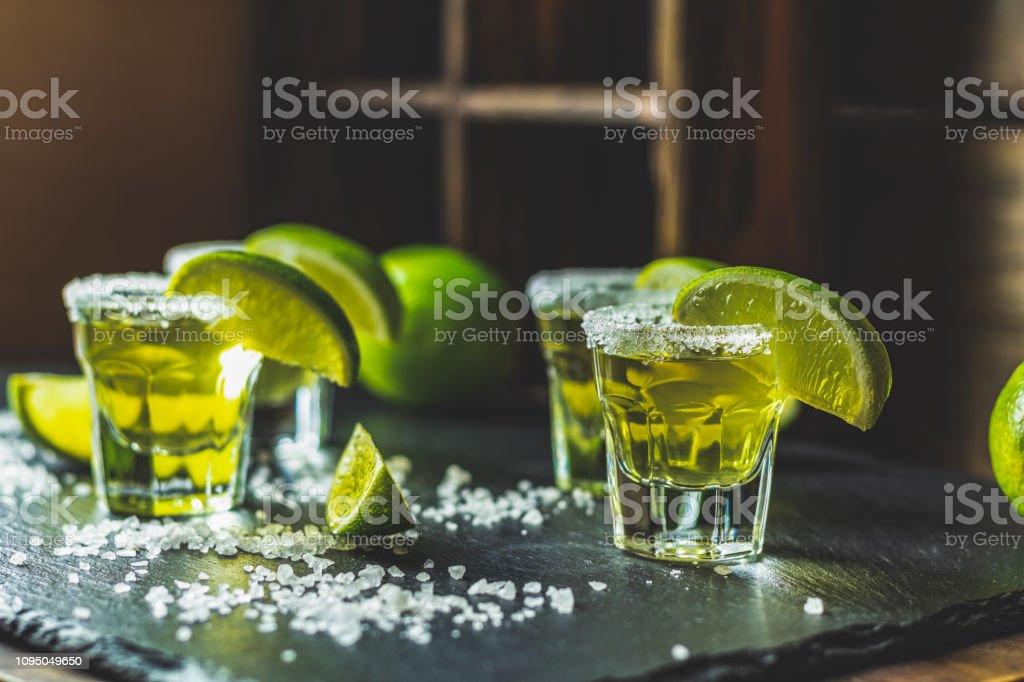 Mexican Gold Tequila shot with lime and salt stock photo