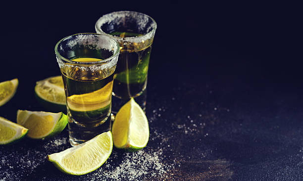 Cтоковое фото Mexican Gold Tequila with lime and salt on wooden table