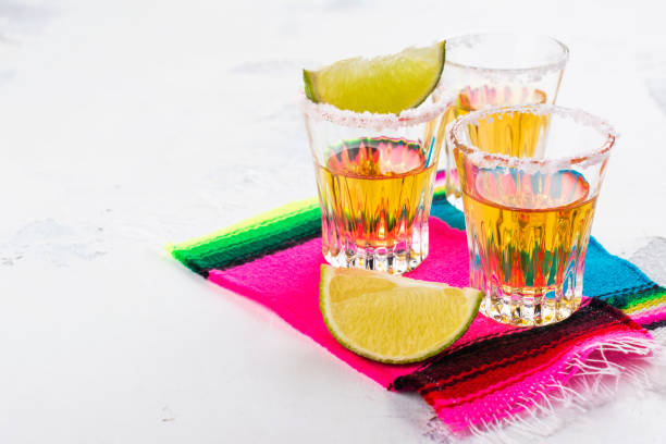 mexican golden tequila shots - cinco de mayo party stock photos and pictures
