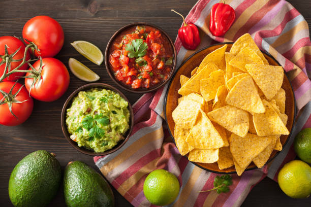 mexican guacamole and salsa dip, nachos tortilla chips - mexican food stock photos and pictures