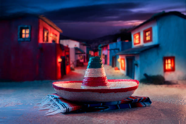 """Mexican hat """"sombrero"""" on a """"serape"""" in a mexican village at twilight"""