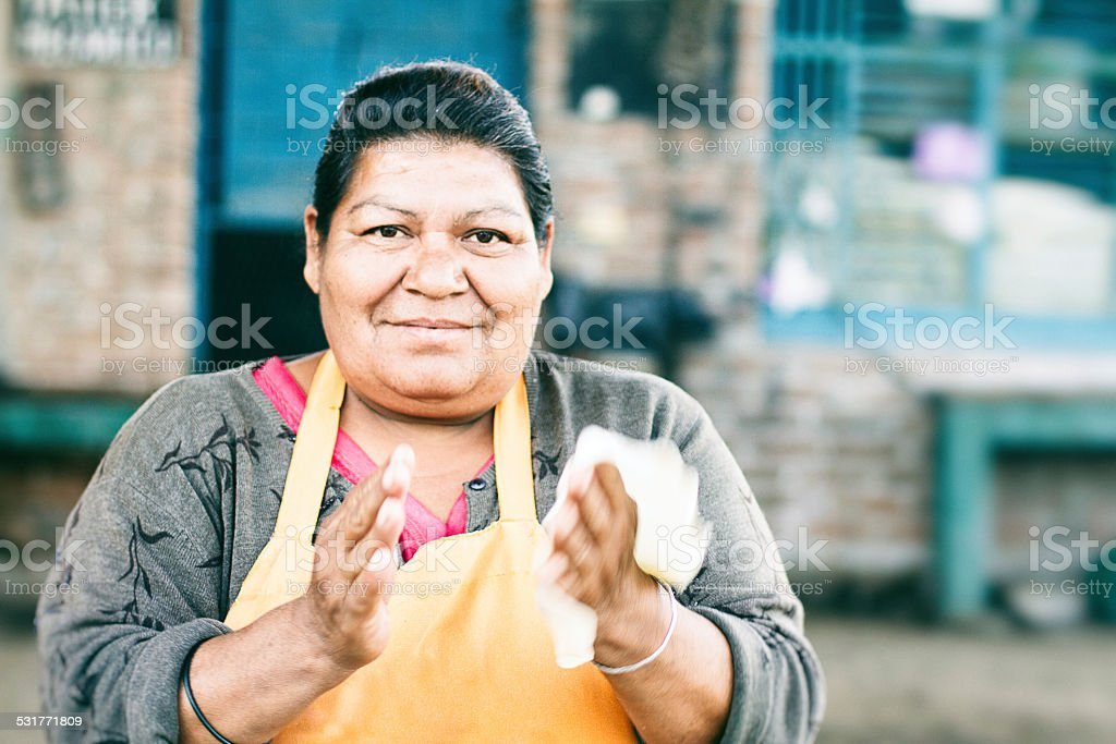 Mexican Lady Making Tortillas stock photo