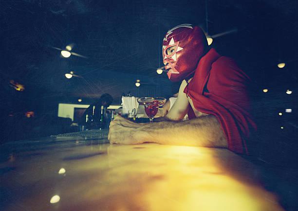 mexican luchador at a bar stock photo