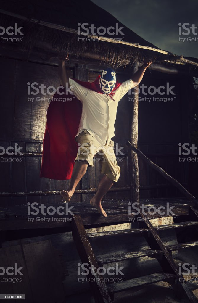 mexican luchador attacking stock photo