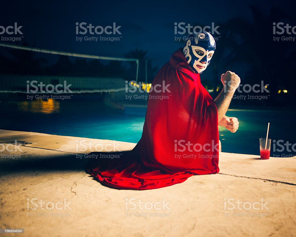mexican luchador by the pool stock photo