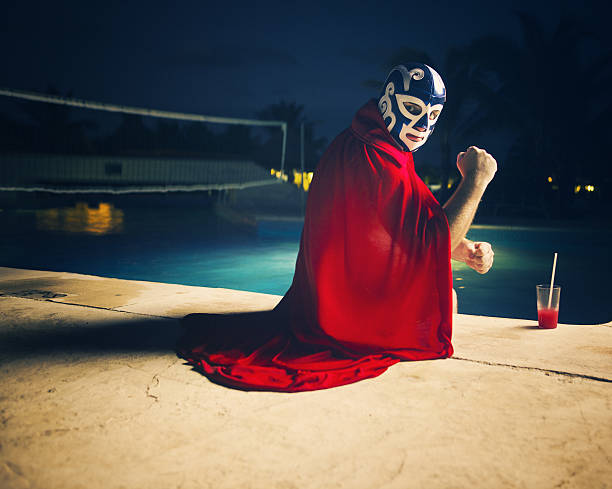mexican luchador by the pool - wrestling stock photos and pictures