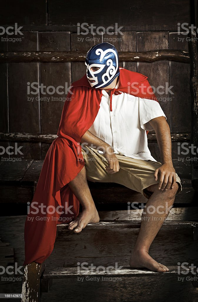 mexican luchador thinking about his next match stock photo