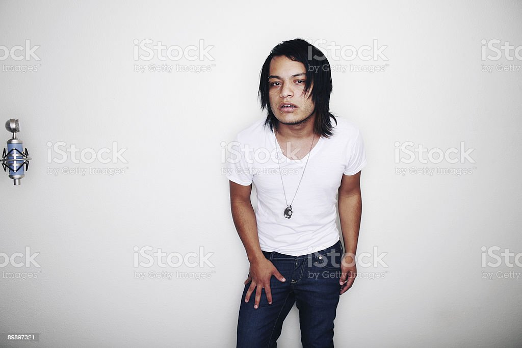 Mexican Man with Long Hair and Microphone royalty free stockfoto