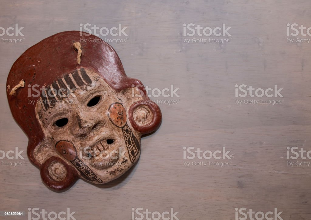 Mexican Mayan Aztec wood and ceramic mask, scary face Lizenzfreies stock-foto