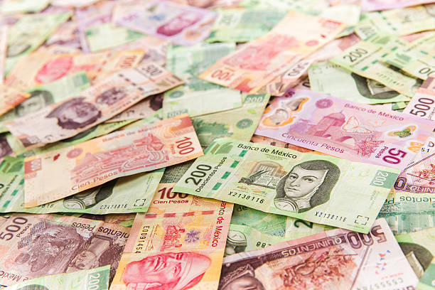 Mexican money background / selective focus