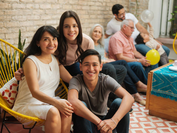 Mexican mother and children smiling at camera stock photo