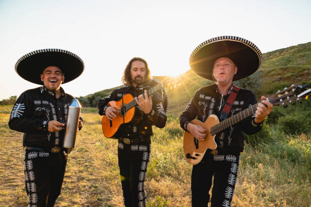 Mexican musicians mariachi Mexican musicians mariachi in traditional costumes at sunset serenading stock pictures, royalty-free photos & images