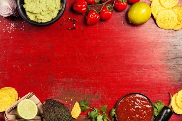 mexican nachos chips with homemade fresh guacomole sauce and salsa - mexican food stock photos and pictures