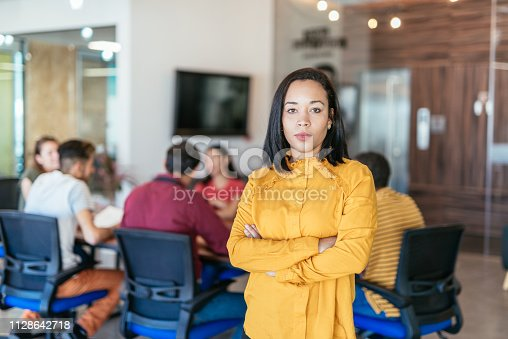 istock Mexican or Latina businesswoman having speech at board room 1128642718