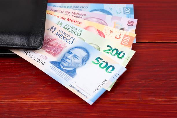 Mexikanische Peso in der schwarzen Brieftasche – Foto