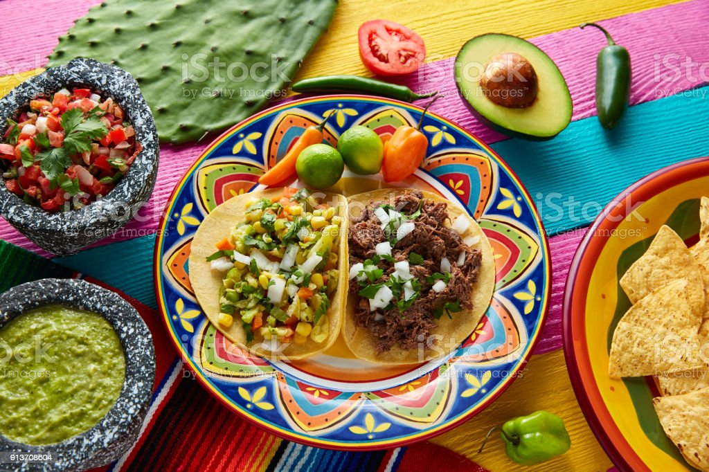 Mexican platillo tacos barbacoa and vegetarian stock photo