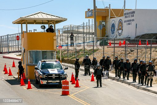 istock Mexican police outside of the El Hongo penitentiary in Baja California in northern Mexico 1223455477