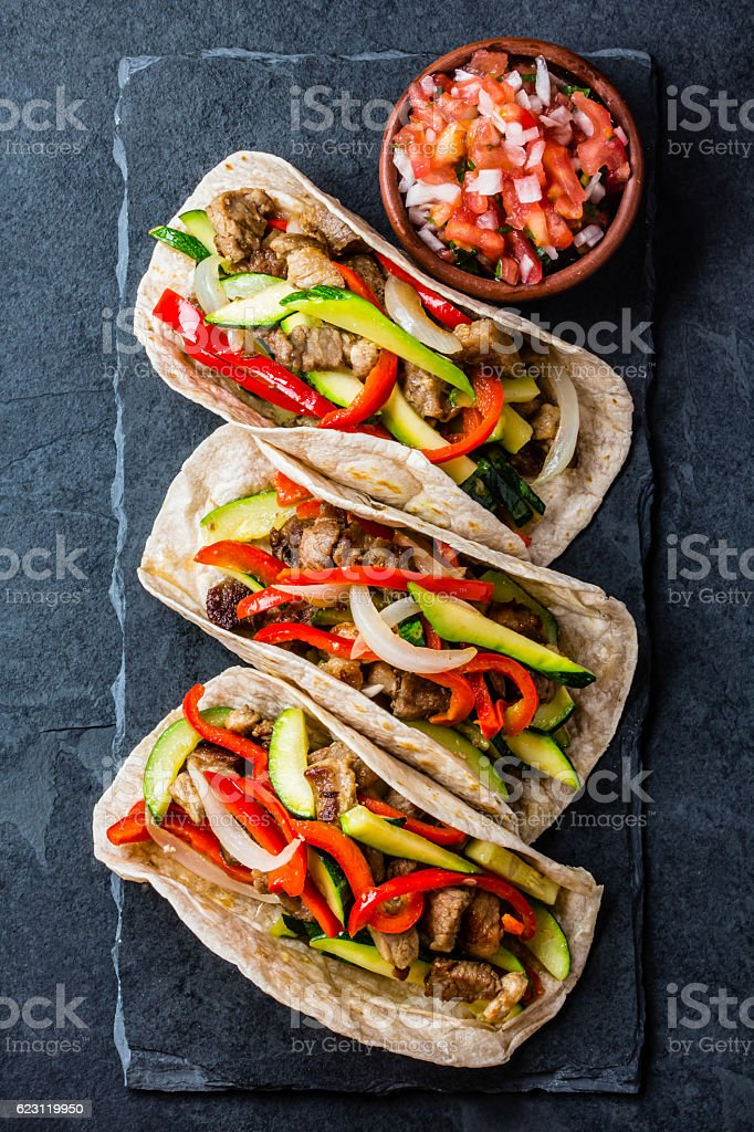Mexican pork tacos with vegetables. Top view stock photo