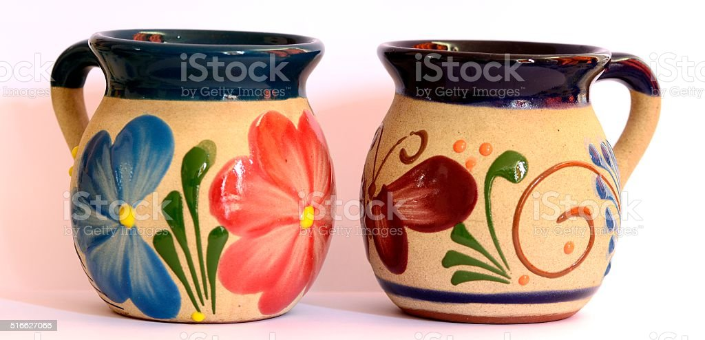 Mexican pottery, two traditional cups, flower and butterfly stock photo