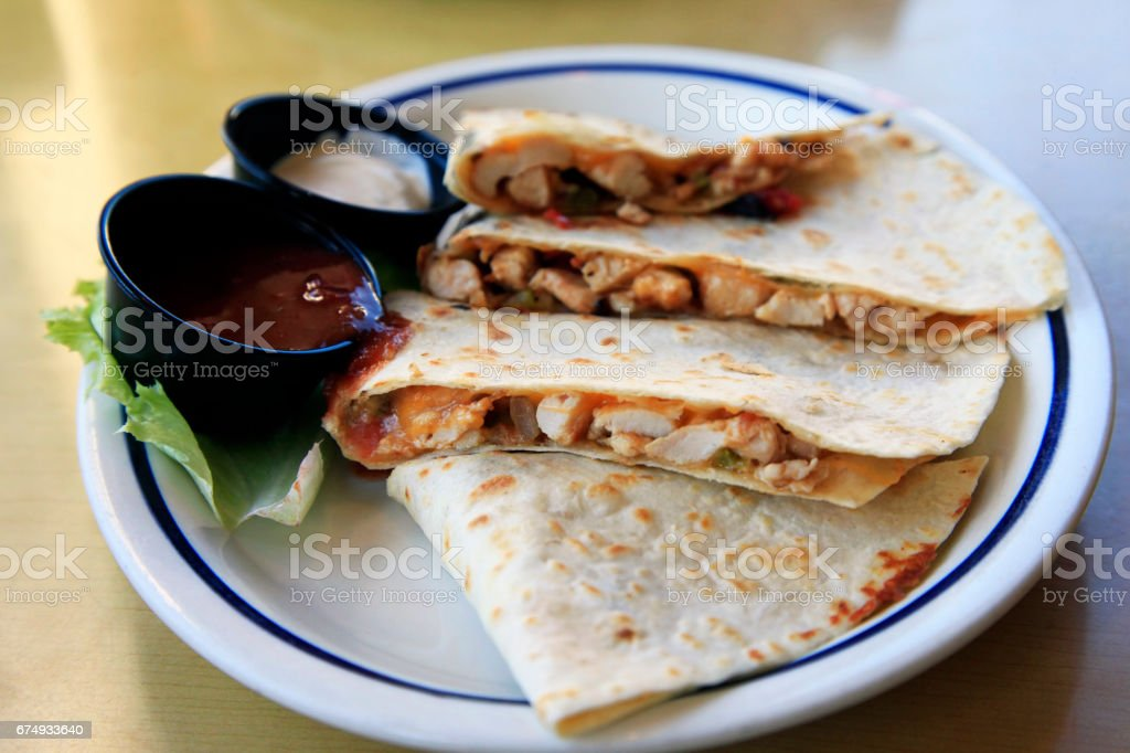 Mexican Quesadilla with chicken and two sauces stock photo