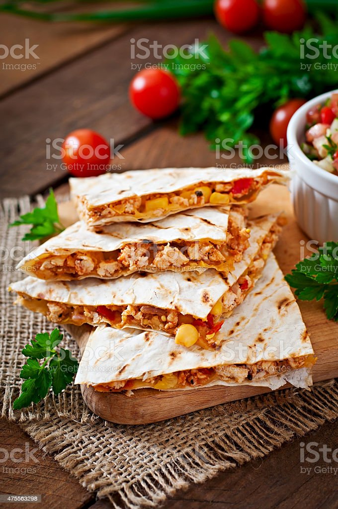 Mexican Quesadilla wrap with chicken, corn and salsa stock photo